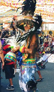 English: A man dressed in a colorful costume o...