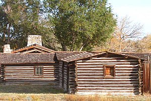 English: Reconstructed buildings at the site o...