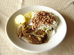 Rice, beans, meat and potatoes, as served in a...