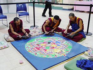 Monks working on Sand Mandala at Nashua High S...