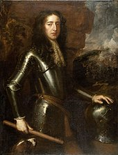 portrait of a man clad in armour, looking right