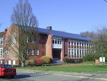 English: Building with solar panels on the roo...