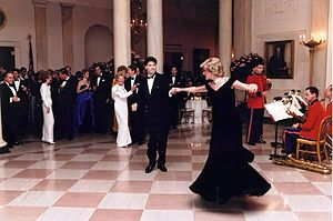 Photograph of Princess Diana dancing with John...