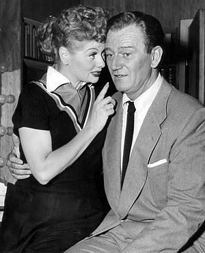 Publicity photo of John Wayne and Lucille Ball...