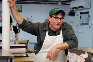 English: Tom Mylan in his butcher shop, The Me...