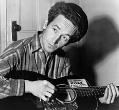 Woody Guthrie, half-length portrait, seated, f...