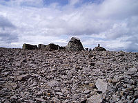 The summit plateau. The ruined observatory is ...