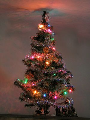 A Christmas tree made of small fir twigs embed...
