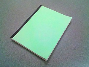 English: Paperback book with green cover.