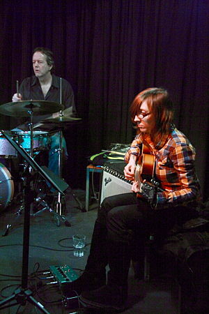 English: Mary Halvorson with Tom Rainey and An...