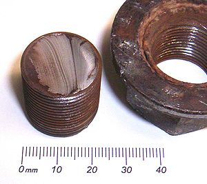 broken bolt from a wheel of a lorry / gebroche...