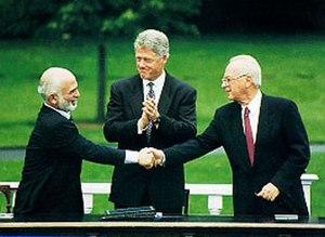 English: A handshake between Hussein I of Jord...