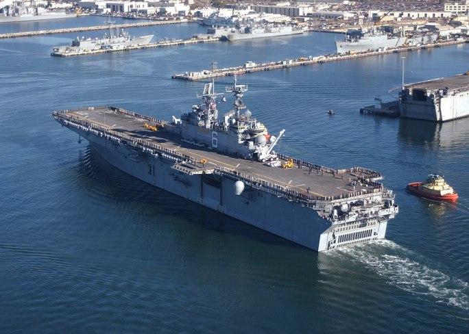 "US Navy 030117-N-2069B-007 Sailors aboard USS Bonhomme Richard (LHD 6) ""man the rails"" as the amphibious assault ship heads to"