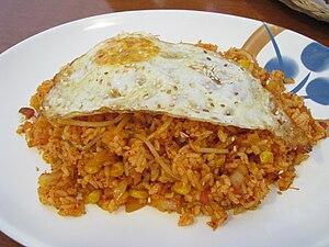 Kimchi bokkeumbap, kimchi fried rice in Korean...