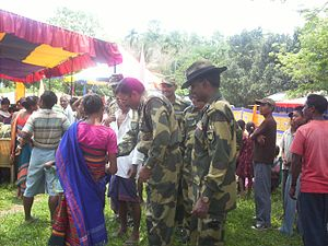 English: BSF men helping boder population in t...