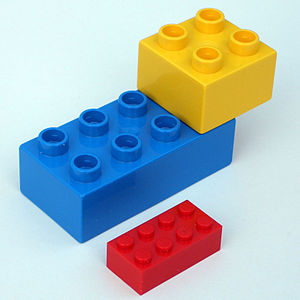 Two Duplo and one normal Lego bricks, photo ta...