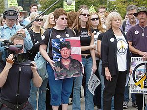 Friends and family of Cindy Sheehan hold a pho...