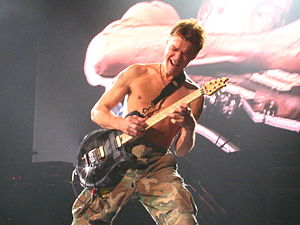 Eddie Van Halen shredding his guitar while pla...