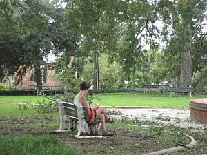Old section of Natchez, Mississippi. Woman sit...