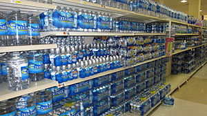 English: Bottled water fills an aisle in a sup...