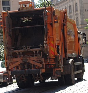 Waste collection vehicle operating in the stre...