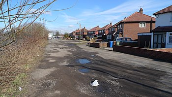 English: Pot-holes on Nelstrop Road North This...
