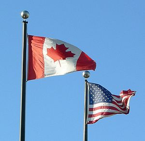 The flags of Canada and the United States of A...