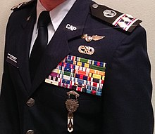 A Civil Air Patrol Cadet Colonel Who Is Also An Enlisted Member In The Force Reserve Or National Guard Wearing Style Service Dress