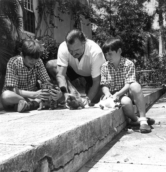 Hemingway with his sons and their cats in Cuba, courtesy of Wikipedia