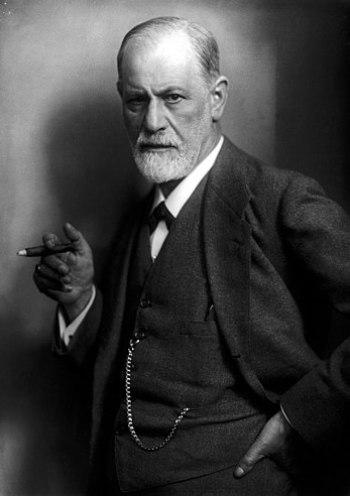 Sigmund Freud, founder of psychoanalysis, smok...