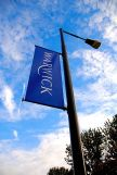Warwick logo an a flag on University Road, The...
