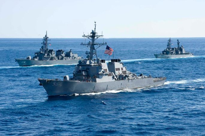 US Navy 101210-N-9626Y-052 USS John S. McCain (DDG 56) joins a combined formation of twenty-six Japan Maritime Self-Defense Force (JMSDF) and U.S