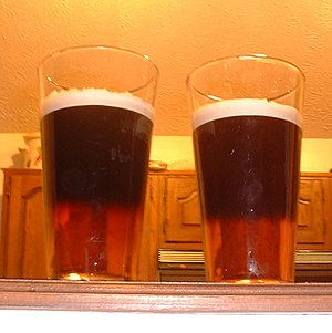 This is a black and tan made with Guinness (dr...