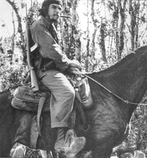 Ernesto Che Guevara on a mule in Las Villas, Cuba