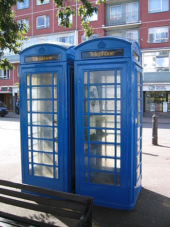 English: Blue telephone boxes in St Peter Port...