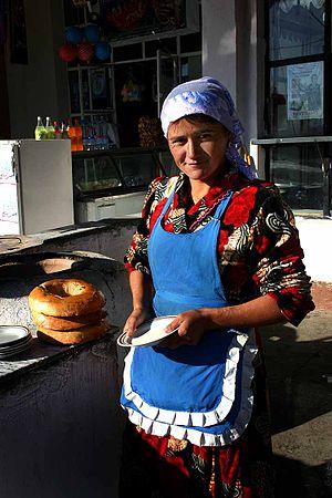 An Uzbekistani woman getting ready to prepare ...