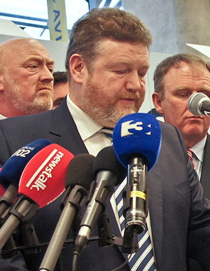 James Reilly (in front of microphones).