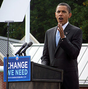 Barack Obama speaking at a campaign rally in A...