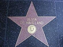 Estrella de cinco puntas con su nombre y la imagen de una vieja cámara de cine.