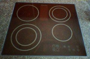 A :en:glass-ceramic cooktop. Model of :en:2004...