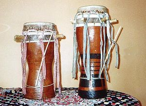 Two Sabar drums from Senegal. On the left a Mb...