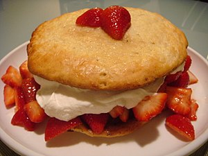 Strawberry shortcake on white plate.