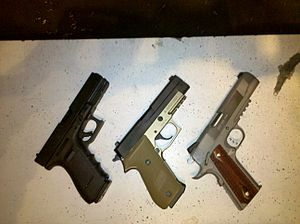 English: Caliber .45 ACP Pistols. From left to...