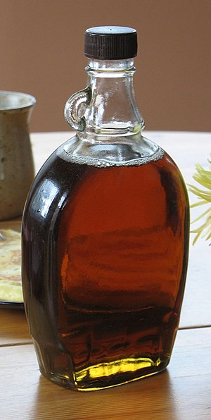 Small maple syrup jug with non-functional loop...