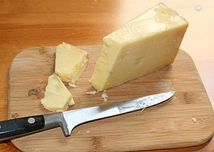 A wedge of Unpasteurised West Country Cheddar ...