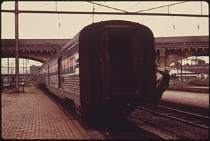 AMTRAK TRAIN BACKS UP TO HOOK UP WITH PASSENGE...