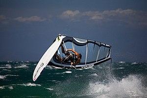 English: Italy, Sardinia: windsurfing at Porto...