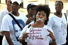 Thousands of people in Paramaribo conduct a silent march on April 10, 2012 against the amnesty law