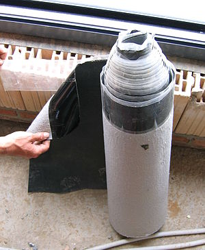 A roll of EPDM foil, used for waterproofing roofs