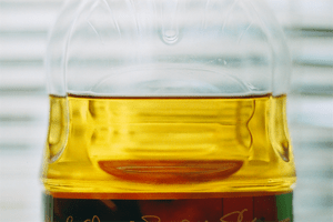 Clear apple juice from concentrate in a bottle.